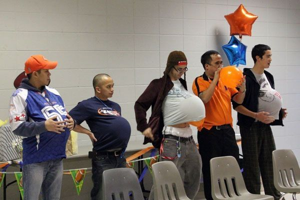 Great Baby shower game. Have volunteers blow up balloon and place under their shirts. They then sit down and tie their shoes to see who can do it the fastest without popping the balloon. Great fun! by laurie