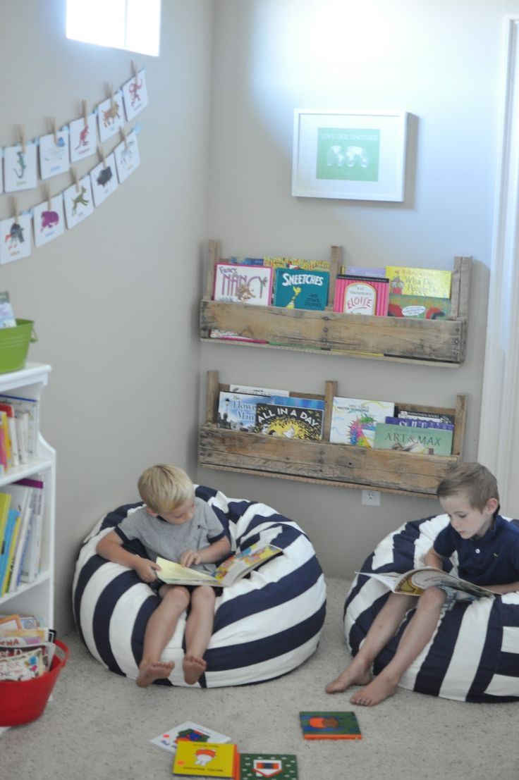 Love the stripe bean bags and wood book storage