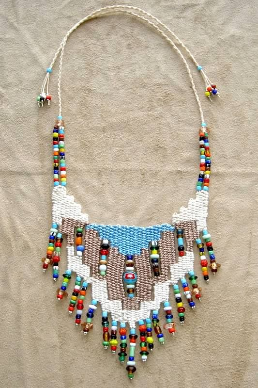 """Turquoise"" - 2010 - Adjustable length, stairstep design, beads woven in, SOLD.  Two other necklaces were based on this design (Southwest and Southwest II) at a customer's request.  Woven by Terri Scache Harris, theravenscache.shutterfly.com   Hand woven, handwoven, weaving, weave, needleweaving, pin weaving, woven necklace, fashion necklace, wearable art, fashion necklace, fiber art."