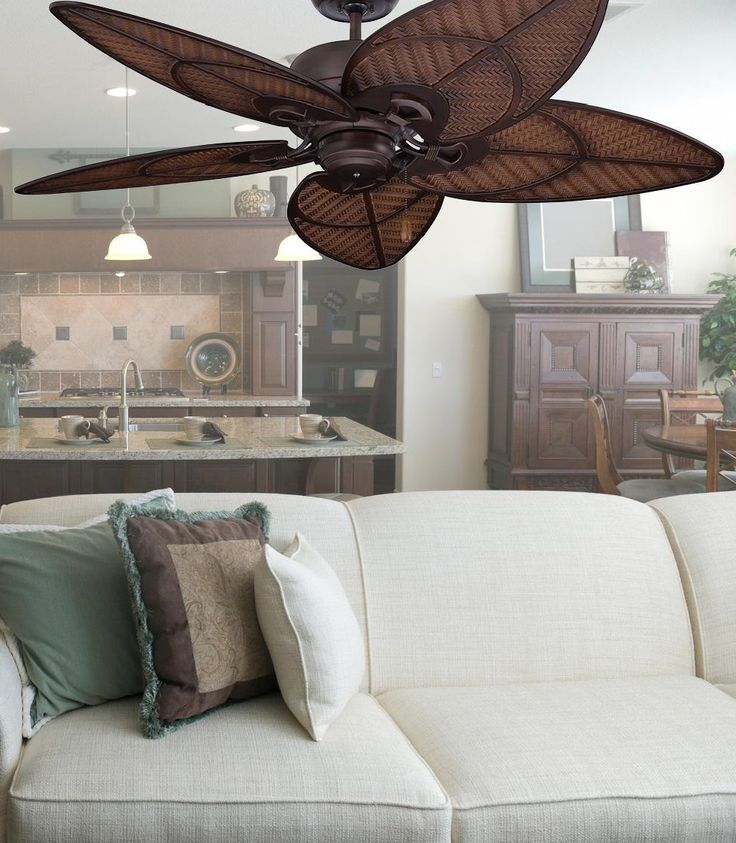 This attractive ceiling fan features five wicker blades in a tropical design and a Venetian bronze finish. The weather-resistant blades make this fan the perfect accessory for your patio.