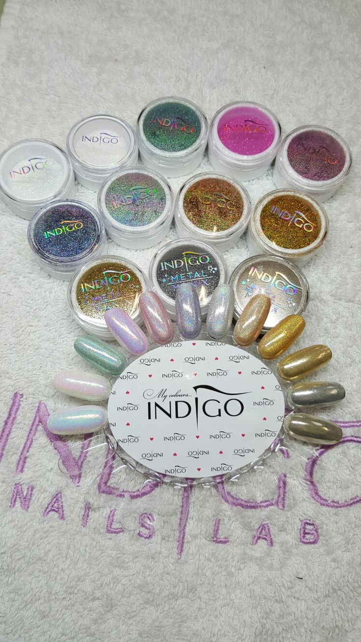 Indigo Nails lab effects on white base. Mermaid. Emerald. Tiffany. Pastel pink. fuchsia. Silver holo. Silver. Grapefruit. Gold. Metal manix light gold. Metal manix silver and Metal manix multi Chrome. From left to right.