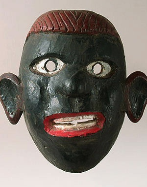 Older Negrito mask    Highland Quichua people, Ecuador    10 inches, painted wood    The depiction of Negros in Andean folk art does occur. There are few black skinned people living in the mountains and more in the nearby Western lowlands. Our Negrito is roughly carved out of hardwood, probably used for a religious holiday. Older, authentic Ecuadorian masks like this one are rare and very desirable.