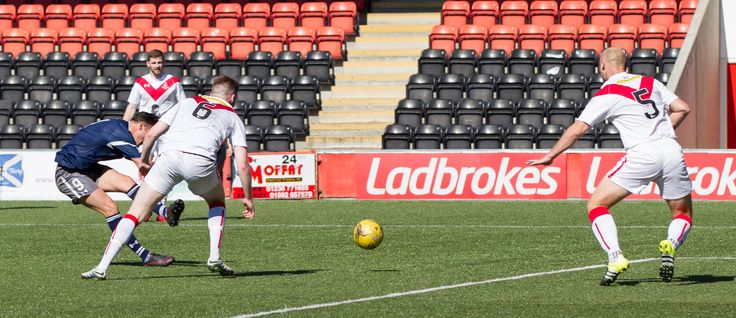 Queen's Park's Kalvin Orsi scores during the Ladbrokes League One game between Airdrieonians and Queen's Park.