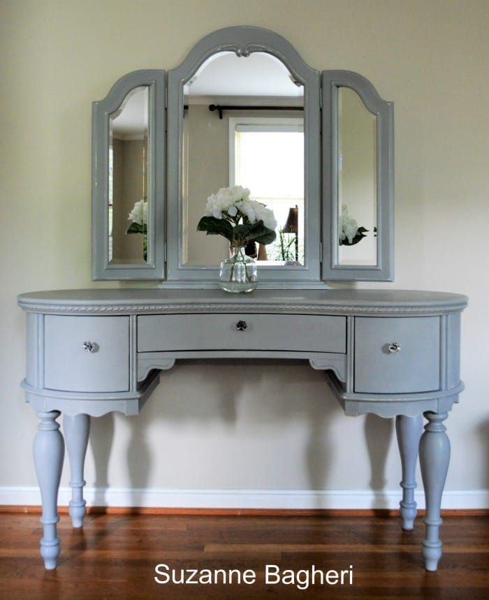 I just finished this gorgeous vanity with mirror. Annie Sloan Paris Grey gave it the perfect classic finish and this newer piece now has charm!