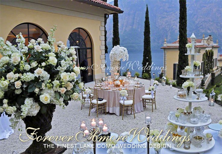 Elegant wedding reception at Lake Como's Villa Balbianello, Terrace of the Loggia Segrè. Decorations in white, ivory and gold. Picture by ForeverAmoreWeddings ©
