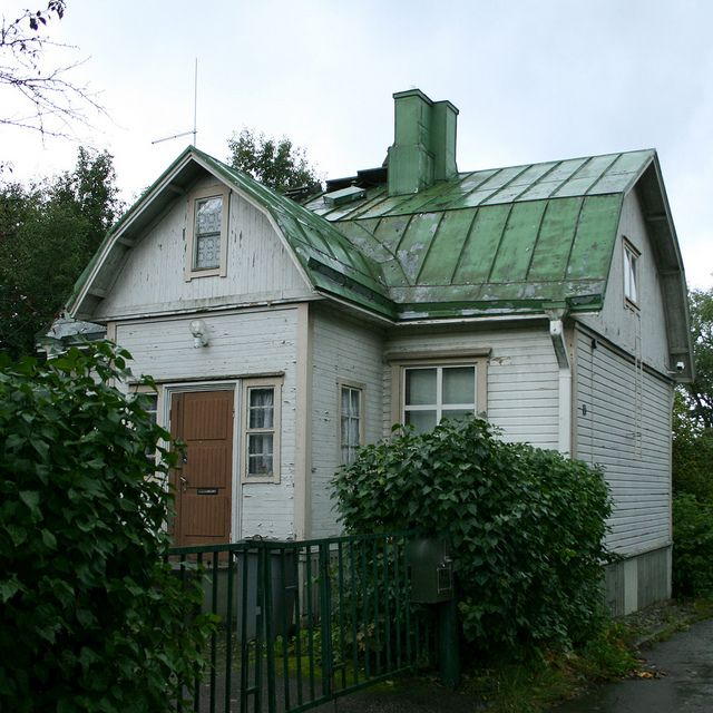 Finland; old finnish wood house; architecture; white wall, green tin roof.