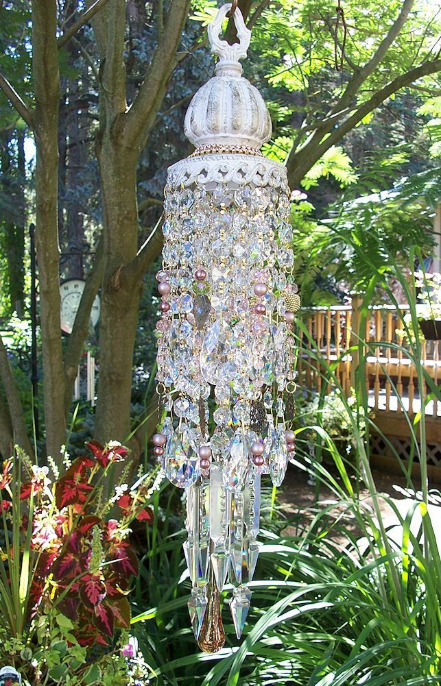 Made from an old hanging light fixture.  Jeweled Victorian Garden Antique Crystal Wind Chime