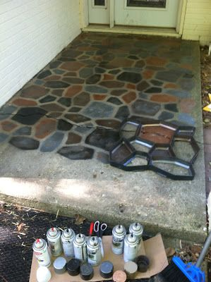 "Smart Mamma says, ""I used a stepping stone mold as a template and flipped it upside down. I then spray painted each section. (I used Rust-Oleum Hammered spray paint) I had 6 different colors of spray paint. Sometimes I mixed the spray paint colors to make the stones look real. After the spray paint dried I applied concrete sealer."""