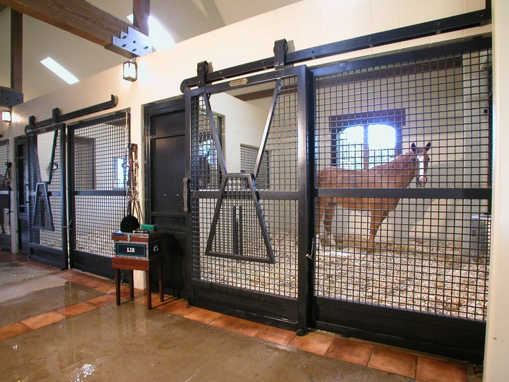 Inside the incredible barn at Speetzen Equestrian Estate in Horsehoe Bay, Texas.  Designed by GH2 Gralla Equine Architects. Lucas Equine stalls.