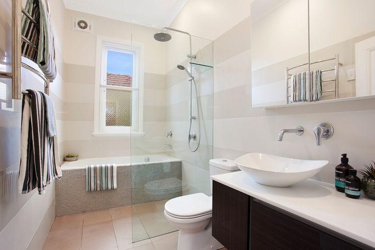 Sleek bathroom, bath & separate shower, heated towel rack, vanity, Pilcher Residential