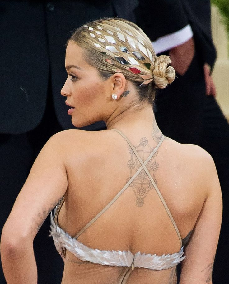 Rita Ora's mirror hair tattoos are all business in the front, party on the side.