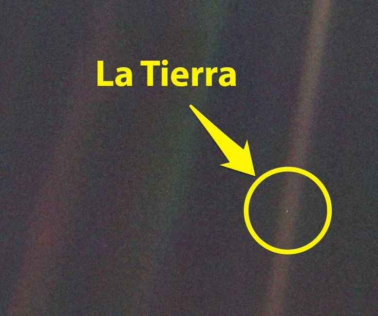 La-Tierra/  pequeño punto azul en medio de un rayo de sol