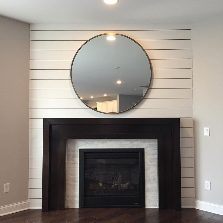 Fireplace accent wall is complete  ...now about the rest of the space... #dgddesign #dgdhomeproject #workinprogress #fireplace #westelm #shiplap #eclecticdecor