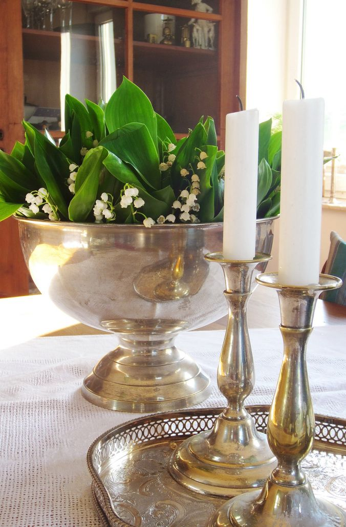 Silver for spring: Lillies of the valley in a champagne cooler.