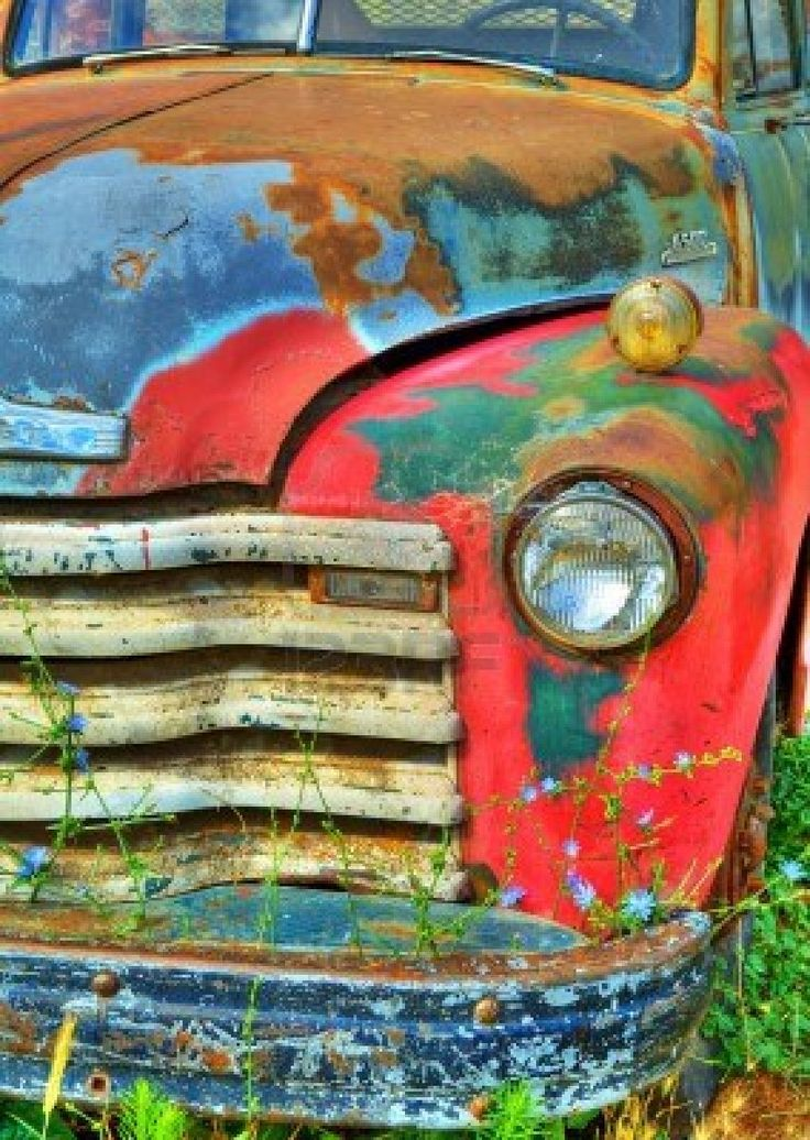 11419264-detail-of-the-front-end-of-an-old-rusted-abandoned-vintage-truck--there-are-wild-flowers-growing-in-.jpg (852×1200)
