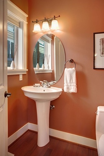 Seattle Hawthorne Hills Contemporary Craftsman - I selected this Benjamin Moore Audubon Russett paint color for the builder years ago and it still works today for a powder room. A great toned down orange tone with white that picked up the colors in the brazillian cherry floors.