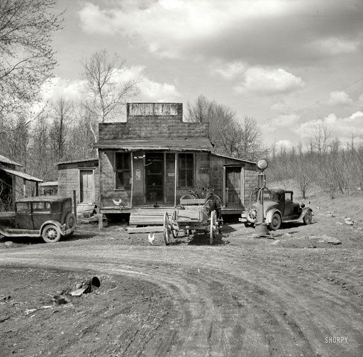 Buttermilk Junction, Martin County, Indiana: 1937 - Gas pump is at the right corner of the building.  Notice chickens on porch and in front of steps.