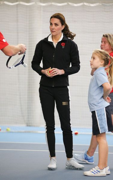 Kate Middleton Photos - Catherine, Duchess of Cambridge, takes part in a Tennis for Kids session during a visit at the Lawn Tennis Association (LTA) at the National Tennis Centre on October 31, 2017 in southwest London, England. The Duchess of Cambridge, who became Patron of the LTA in December 2016, visited the LTA, the national governing body of tennis in Great Britain, where she was briefed on the organisations latest activities and objectives, and had the opportunity to watch a number of…