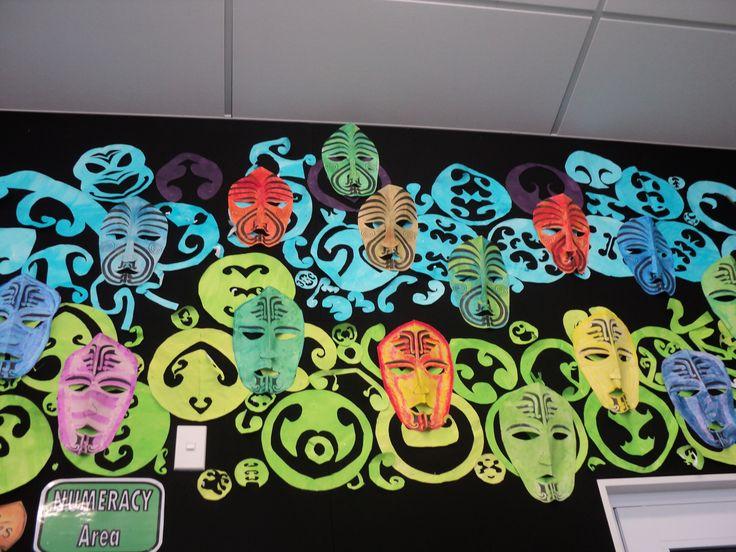 Maori masks depicting Maori gods. The symmetrical motifs in the background were part of a mathematics lesson.