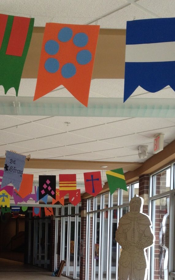 Kingdom Chronicles VBS. Hanging Banners in the entrance. Flag Banners were made using craft foam sheets.