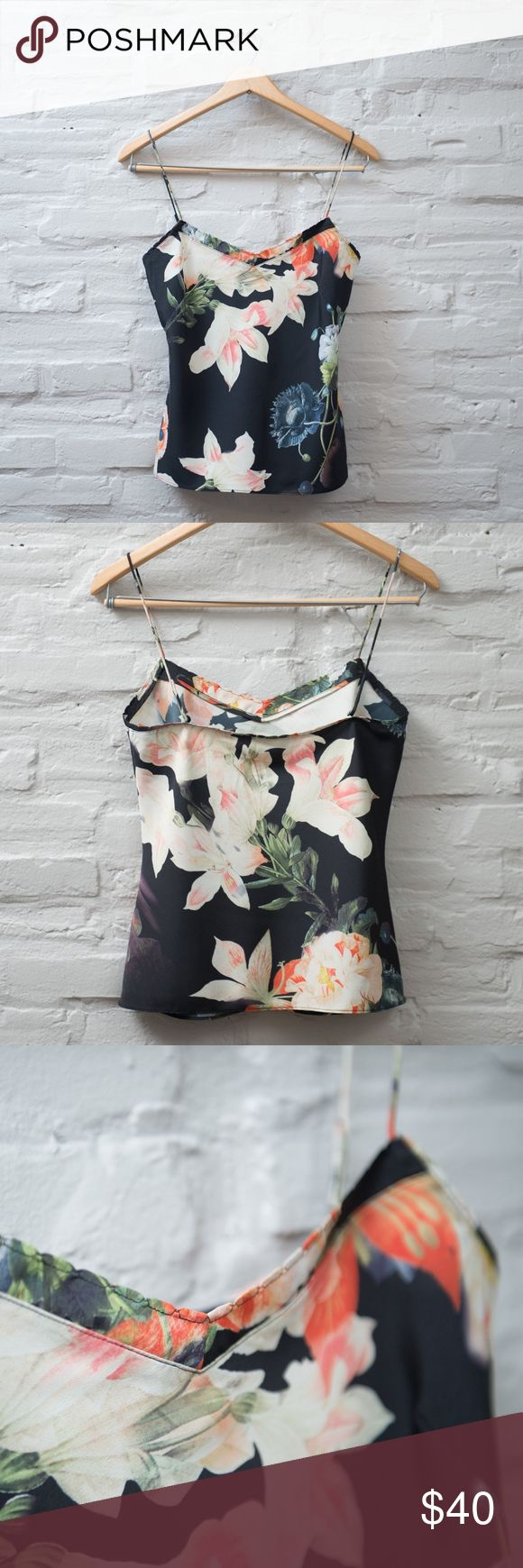 Ted Baker Cynaria Cami Classic Ted Baker cami in black with a floral print. Sustainably minded with a makeup of 56% polyester and 44% recycled polyester. Scalloped neckline. Size small but definitely made for a petite woman. My dress form is a size 2-4 and it did not fit over the bust. Ted Baker London Tops Camisoles