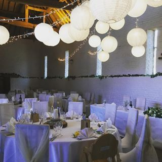 White and cream paper and lace lanterns from @oakwoodevents looked stunning in our #tithebarn for today's #uftoncourtwedding. Chair covers and sashes by @eventsfor_u. #lightingspecialists #weddinglighting #weddingdecor #venuedressing #lightingdisplays #hanginglanterns