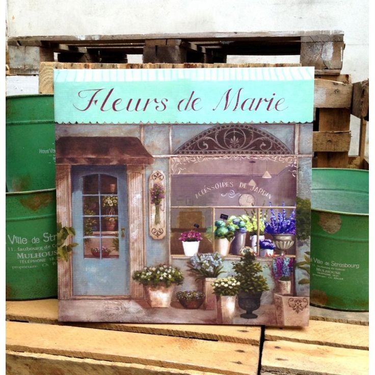 Obrazek ten przedstawia francuska kwiaciarnię. Uroczy , w pięknej kolorystyce wniesie do mieszkania prowansalski klimat.