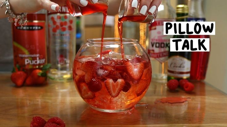 PILLOW TALK 1 oz. (30ml) Strawberry Vodka 1 oz. (30ml) Raspberry Vodka Mini Champagne Bottle Strawberries Raspberries Shot #1 1/2 oz. (15ml) Strawberry Liqueur 1/2 oz. (15ml) Watermelon Pucker Shot Shot #2 1/2 oz. (15ml)Strawberry Daiquiri Mix 1/2 oz. (15ml) Grenadine PREPARATION 1. Cut a triangle into a strawberry from the top and slice it to resemble hearts. 2. Build a glass using ice, raspberries, and the heart shaped strawberry slices. 3. Pour in strawberry vod...