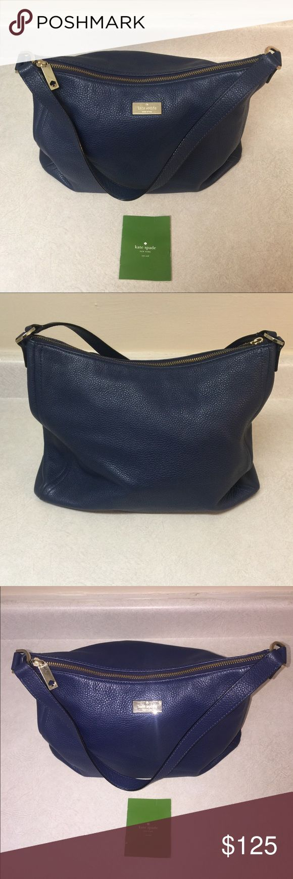 ♠️Kate Spade Leather Hobo♠️ Good condition. Navy blue color. I used the flash on camera for a better view in some pictures. This was an everyday purse for me. No cracks or tears in straps. No stains or tears on outside of purse. There are brown stains on inside lining that could be easily cleaned. There is also a small ink line at bottom of purse which can be seen in picture if you zoom in. Comes with care card. kate spade Bags