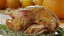 In this method, which can be used with all types of poultry, olive oil infused with garlic and rosemary is rubbed between the skin and meat of the bird before roasting.