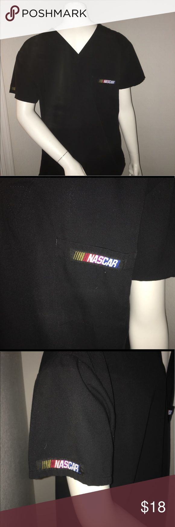 """Unisex medical dental nascar scrub top sz: Xs Thank you for viewing my listing, for sale is a unisex, men/women, blacks, short sleeve, NASCAR brand, medical/dental, scrub top/shirt.  Sz: XS  Top is in great condition with no rips or stains. If you have any questions or would like additional photos please feel free to ask.  From under one arm to under the other measures appx 21"""" from the top of the shoulder to the bottom of the shirt measures 27"""" nascar Shirts Tees - Short Sleeve"""