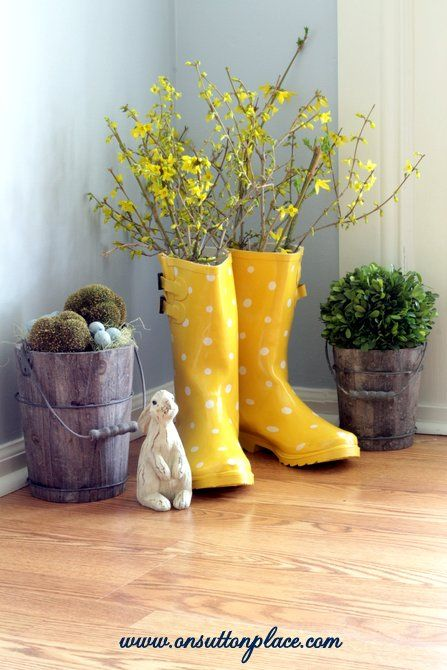 Rain Boot Vase. A cute way to brighten up your home decor for spring. Skip the vase! I love the boots!!! :)