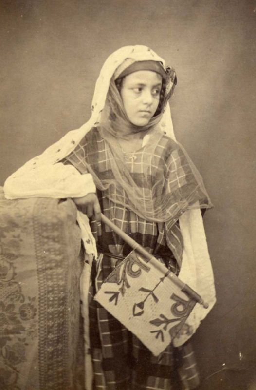 1870 - young lady of Biskra Algeria with a local fan