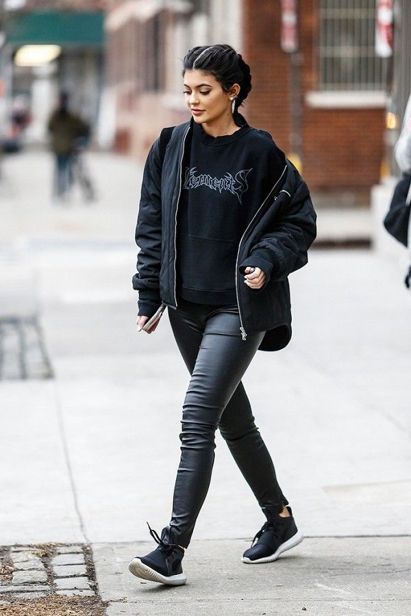 Kylie Jenner looking casual chic in a Vetements sweatshirt.