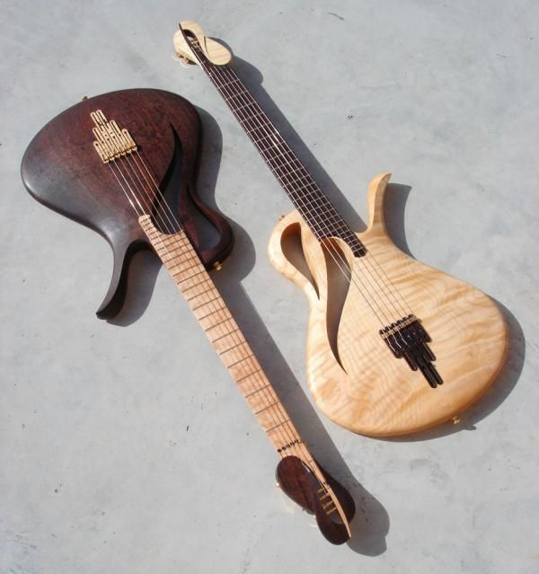 Love the dark wood body and headstock with the light wood fretboard. Its the ultimate combo! Interesting Headstock design.