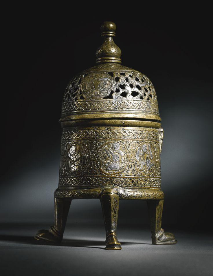 An Ayyubid silver-inlaid cast-brass incense burner, Jazira or Syria, mid-13th century