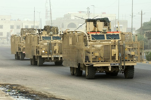 British Mastiff armoured vehicles on patrol during Operation Charge of the Knights-14 in Basrah City with the UK Military Transition Team (MITT) Group attached to 50 Brigade, Iraqi Army in June 2008.    This image is available for non-commercial, high