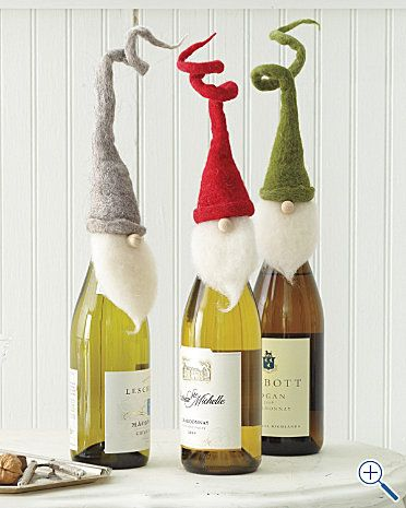 Christmas present idea..whimsical bottle toppers! I bet I could make these from felt for hostess gifts...