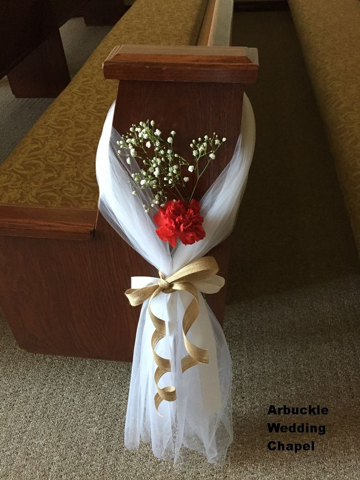 Pew decoration so pretty and easy.  White tulle, burlap ribbon, red carnation, and babies breath. Lovely