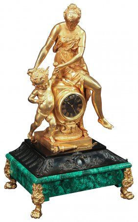 Rare And Important French Dore Palace Clock -   Of Mounumental Size, Surmounted With A Finely Executed Dore Bronze Classic Lady Attending A Putti, With A Quiver Of Arrows And Bow At Their Feet, The Clock Having A Black Marble Roman Numeraled Face, Resting Atop A An Acanthine Black Patinated Bronze Base, All Resting On A Russian Malachite Platform, Supported By Paw Footed Griffon Form Feet, Signed And Dated By Maker, C. Party Scup. 1865, 40 H X 22 W X 17d