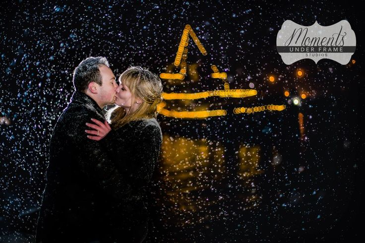 Engagement Photos in the snow, with Tug boat in the background - By Moments Under Frame, Penticton