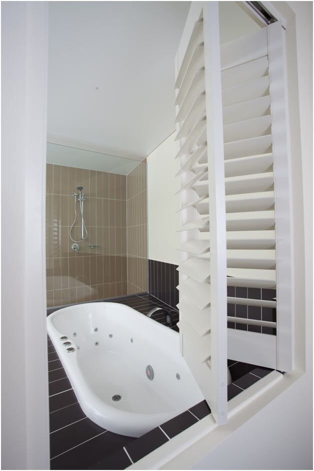 3-Bedroom Grand or Presidential Suite master ensuite's spa, with louvers opening into master bedroom