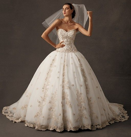 Long strapless white wedding dress with full skirt & lace accents by Amalia Carrara from Eve Of Milady (Style: 315).