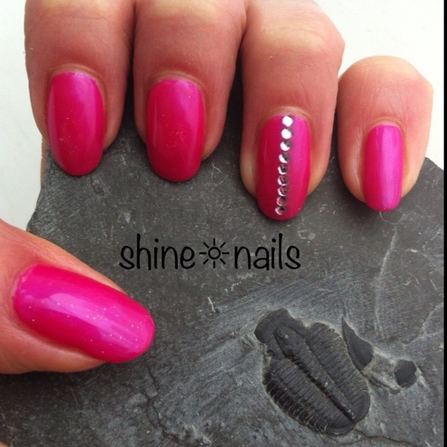 I love a Ring Finger Mani - My Maxi Nails Shellac'd in Tutti Frutti with pink rhinestones. I'm determined to feel summery in spite of all the rain.  By ShineNails
