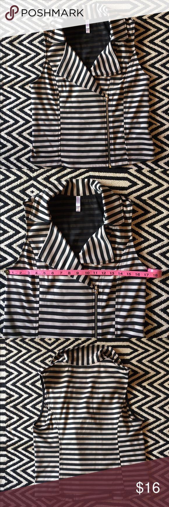 Xhilaration black and tan moto striped vest New without tag. Xhilaration Black and tan moto striped vest. Size. M. Shell: 97% polyester, 3% spandex. Lining: 100% polyester. Xhilaration Jackets & Coats Vests