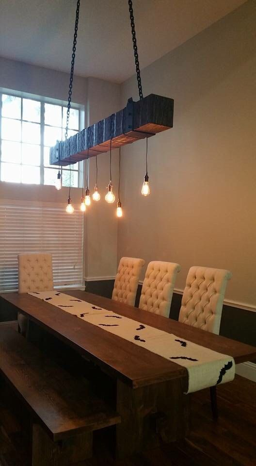 Modern farmhouse lighting made with a reclaimed wood beam for a rustic industrial chandelier with light bulbs, perfect lighting for beams idea! This faux beam is made of 4 reclaimed wood boards and is hollow in the middle. It is light in weight which makes it perfect for using at a rustic chandelier.
