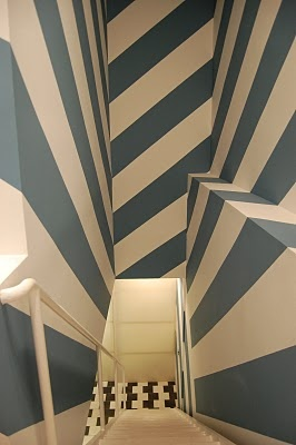 Striped hallway.  Don't think I would have the guts to try this but it's cool to look at!  :)