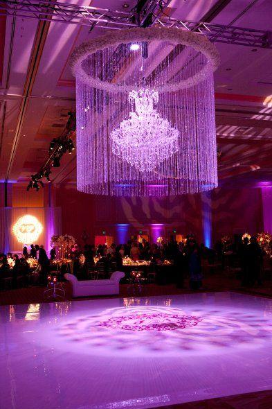Amazing #purple #uplighting and #gobo #monogram on #dancefloor setup at this #wedding #reception in #Orlando #Florida ! #diy #fun #ideas #inspiration #rentmywedding #unique By #OccasionsBySangrila