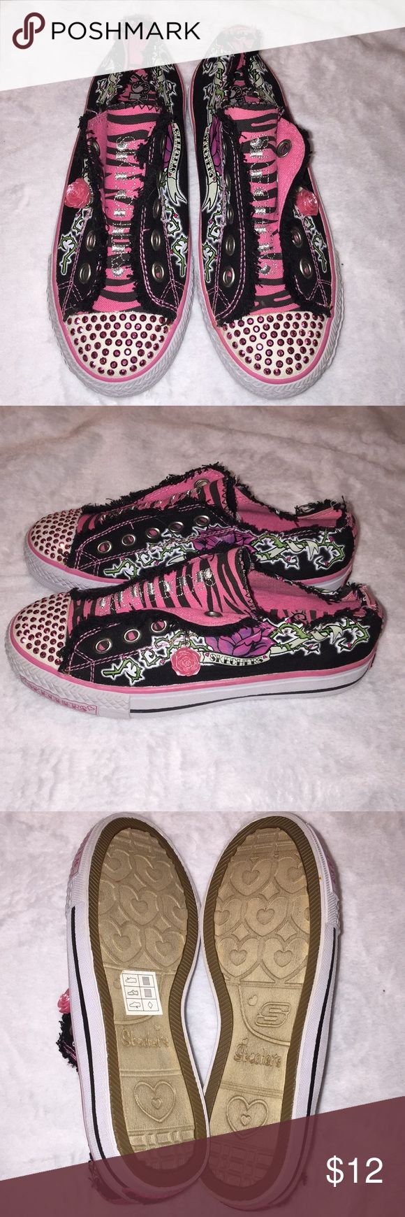 Girls Skechers brand shoes size 2. This is a pair of girls Skechers brand shoes size 2. That have been worn a few times and are in good shape. They are a slip on shoe with a medium width. If you have any questions please let me know. Thanks! Skechers Shoes Sneakers