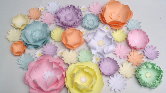 Paper flowers - different shapes, sizes and colors.  Example: 150 beautiful paper card flowers (100$+P&P) in soft yellow, blue, pink, white, lilac, lavender, cream, salmon.  The paper card used is 160 gsm thick.  Approx size of one flower: they vary from 25 cm / 9.84 inch to 8 cm / 3.14 inch in diameter. Find more / contact us: http://lucrurifrumoase.blogspot.com/p/my-sh.html